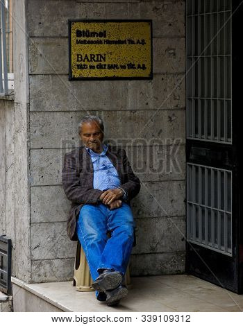Istanbul, Turkey 05/13/2013 An Older Man Leans On A Wall And Snoozes Along The Street