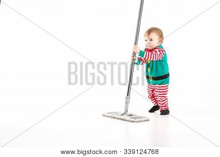 Studio Photo With White Background Of A Baby Disguised As A Elf