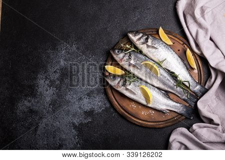 Fresh Raw Whole Sea Bass. Raw Seabass Fish With Spices And Herbs Ingredients. Top View With Copy Spa
