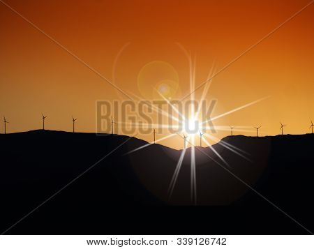 Wind Turbines On A Hill Top At Sunset