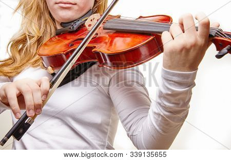 Violin Of A Classical Musical Instrument. Hands Of A Classical Violin Player On A White Background.
