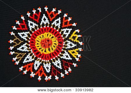 Beaded African design pattern with space for text poster