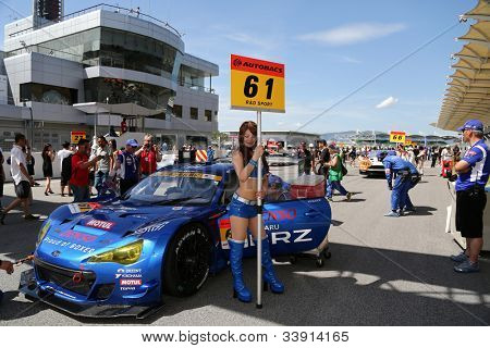 SEPANG - JUNE 10: A grid girl poses with the Subaru BRZ GT300 car of the R&D Sport Team on the start grid at the Autobacs SUPER GT Series Rd 3 on June 10, 2012 at the Sepang Int. Circuit, Malaysia.