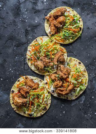 Korean Tempura Fried Shrimp And Coleslaw Tacos On Dark Background, Top View