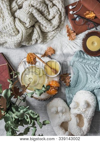 Cozy Home Still Life - Soft Slippers, Knitted Sweater, Plaid, Green Tea With Honey, Tangerines, Dry