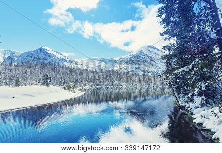 Scenic snow-covered peaks in winter in the Glacier National Park, Montana, USA. Instagram filter.