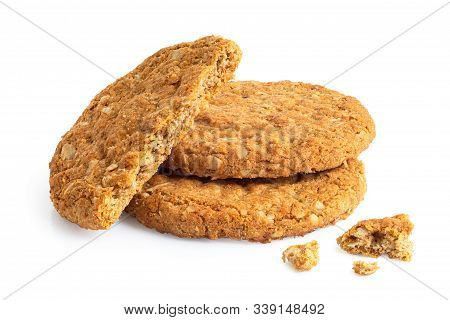 Two And Half Crunchy Oat And Wholemeal Biscuits With Crumbs Isolated On White.