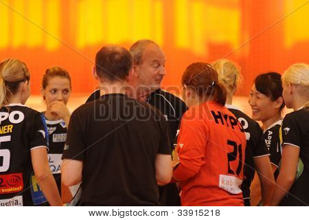 SIOFOK, HUNGARY - AUGUST 24: Andras Nemeth (C) Hypo trainer in action at a Siofok Cup handball game Siofok KC pink (HUN) vs. HYPO NO blue (AUT) August 24, 2008 in Siofok, Hungary.