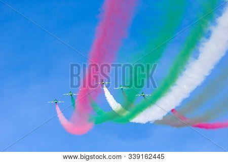 Abu Dhabi, Uae - December 02, 2018: Saudi Hawks Fly In Formation At Al Ain Aerobatic Show On Februar