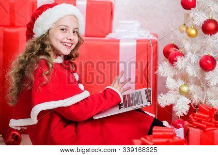 Child Santa Enjoy Christmas Eve. Girl Little Kid Typing Letter To Santa On Laptop. Child Write Lette