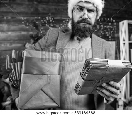 Gifts Delivery Service. Post For Santa Claus. Man Bearded Hipster Wear Santa Hat Hold Bunch Of Lette