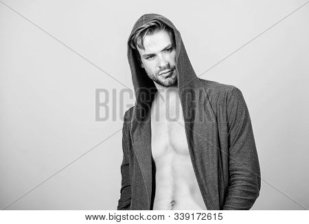 Masculinity Concept. Masculinity And Confidence. Man Muscular Torso Wear Hooded Clothes. Unconventio