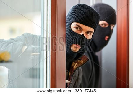 Burglars open patio door from single family home during burglary