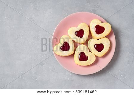 Valentine Cookies In A Pink Plate On Light Background
