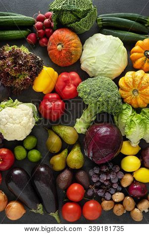 Assortment Of Fresh Vegetables On Dark Background