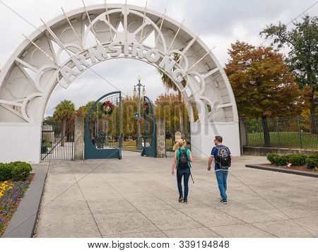 New Orleans, Louisiana, Usa. December 2019. People Walking To The Entrance Of Louis Armstrong Park I