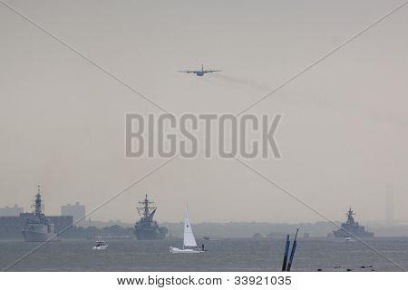 HOBOKEN, NJ - MAY 23: Military KC-130 plane flies along the Hudson River near Manhattan during the Parade of Sails on May 23, 2012 in Hoboken, NJ. The parade marks the beginning of Fleet Week.