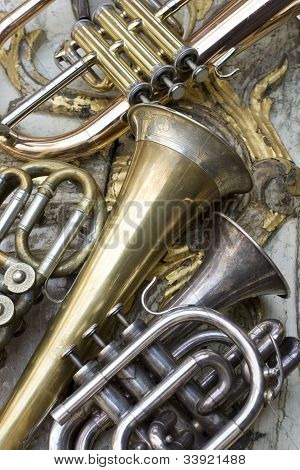A lot of Trumpets on pieces of antique furniture poster