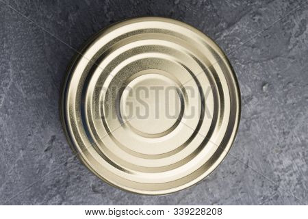 Tin Can On Concrete Background. Top View . Tin Circle Shape On Bottom Of Tin Can