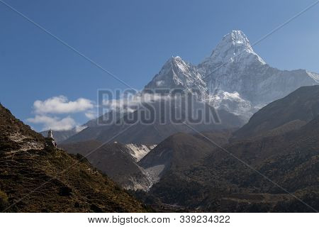 Ama Dablam Is A Mountain In The Himalaya Range Of Eastern Nepal. The Main Peak Is 6,812 Metres, The