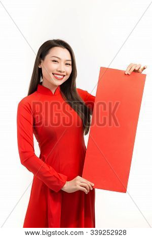 Beauty Women Wear Ao Dai And Show Couplets With Lunar New Year
