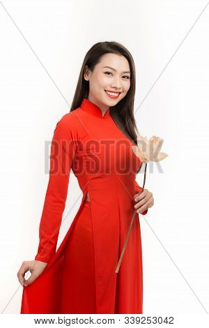 Young Woman Wearing Red Ao Dai Looking Away With Toothy Smile While Holding  Flower Bouquet In Hands