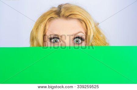 Advertising Banner. Blank Poster. Message Concept. Woman Hiding Behind Billboard. Blonde Girl Peekin