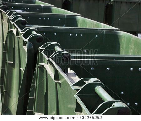 Open Empty Green Plastic Waste Containers (dustbins, Garbage Cans, Trash Cans).