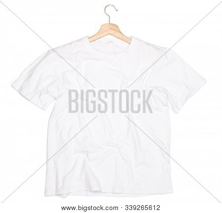 Wrinkled white T-Shirt with hanger lay on a white background isolated