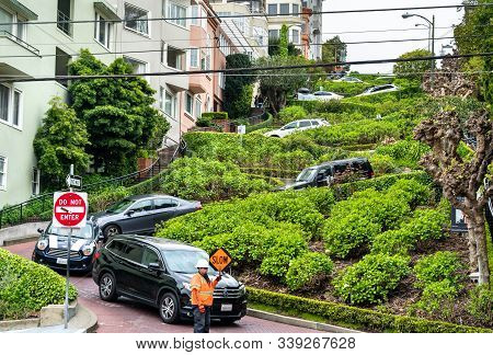 San Francisco, Usa - April 1, 2019: Cars On Lombard Street. Eight Sharp Turns Here Make It The Most
