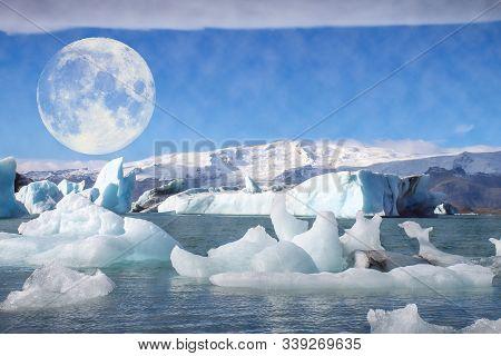 Full Moon Over A Glacier In Winter