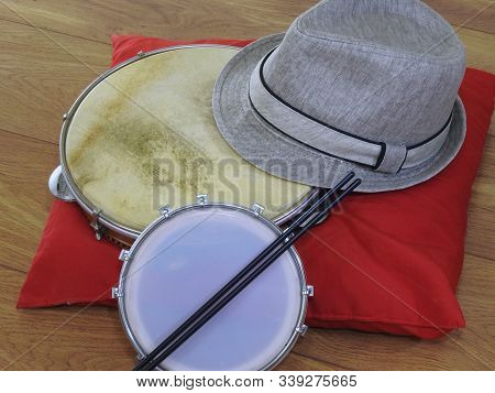 Close-up Of A Samba Player (sambista) Hat And Two Brazilian Percussion Musical Instruments: