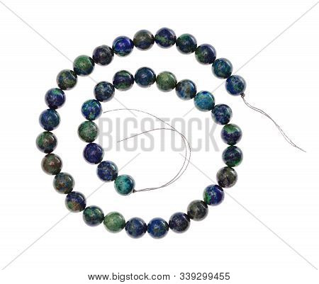 Top View Of Spiral String Of Beads From Natural Azurite Gemstone Isolated On White Background