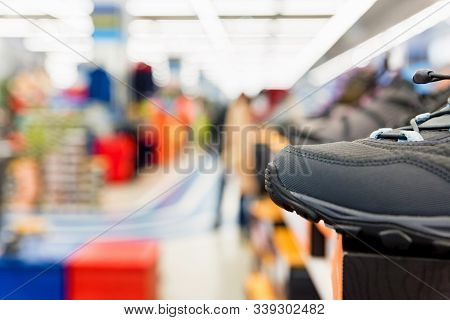 Close Up Sports Shoe In Shop With Blurred Background
