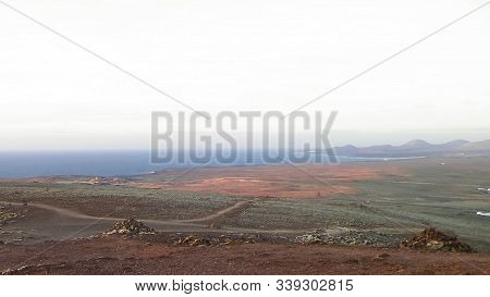 Area Of Montana Roja, Lanzarote, Canary Islands. Montana Roja Is A Volcano In Playa Blanca, Lanzarot