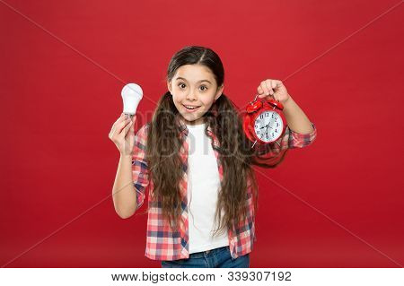 Time Of Lighting. Idea And Inspiration. Inspired Child Hold Clock Red Background. Inspiration And Br