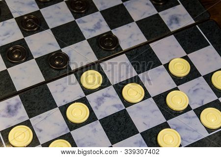 Checkerboard With Checkers. Draughts On Playing Field. Game Concept. Board Game