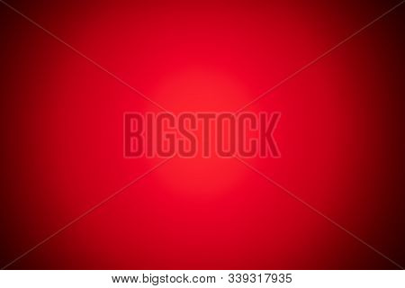 Red Blurred Background With Strong Black Gradient And Strong Vignette