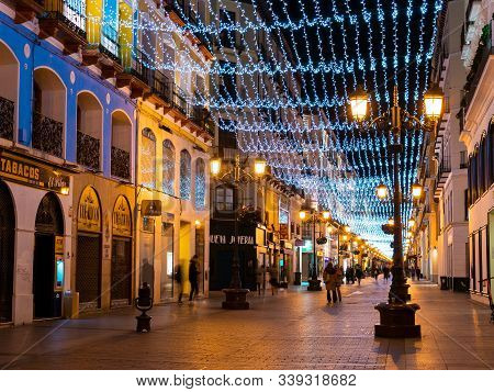 Zaragoza, Spain/europe; 11/12/2019: Night View Of Alfonso Street Decorated With Typical Christmas Li