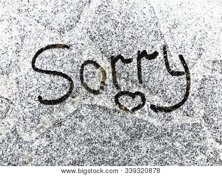 Sorry Text Written On Snowy Surface. Sorry Note. Apologize Concept