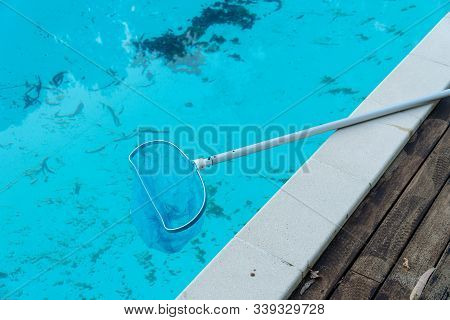 Dirty Swimming Pool With Leaves And Dirt In The Pool Bottom. Cleaning Concept