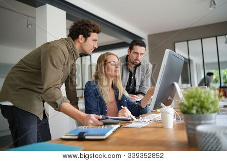 Business team working together in office