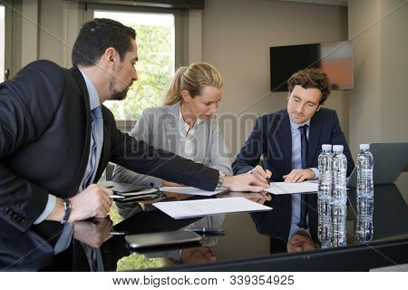Business people attending business meeting