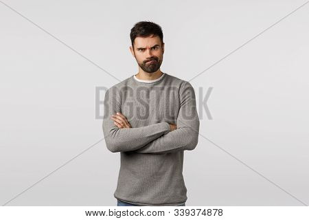 Angry Serious-looking Sulking Man With Beard, Wear Grey Sweater, Cross Arms Over Chest Defensive And