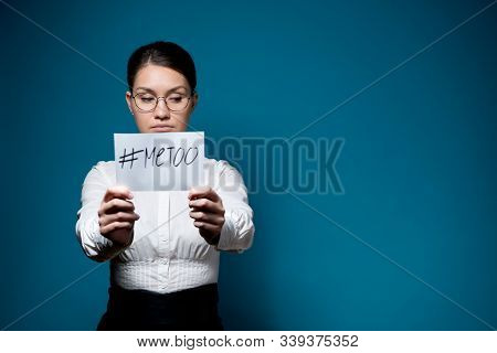 A Girl With Glasses And A White Shirt Hides Her Eyes And Holds In Front Of Her A Sheet With The Insc