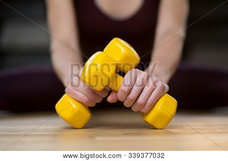 Two Bright Dumbbells In The Hands Of A Girl, Selective Focus