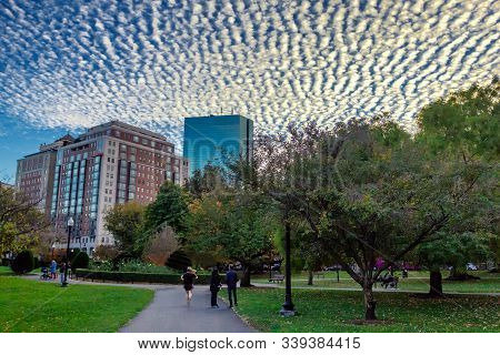 Evening View Of Boston Public Garden With Beautiful Clouds In The Sky