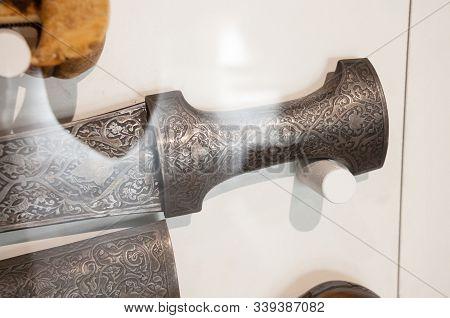 Russia, Vladivostok, July 2018: Seaside Museum V.k. Arsenyev. Sword Handle With Ornament.