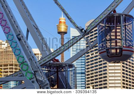 Sydney, Nsw, Australia - November 24, 2015: The Darling Harbour Ferris Wheel And The Sydney Tower