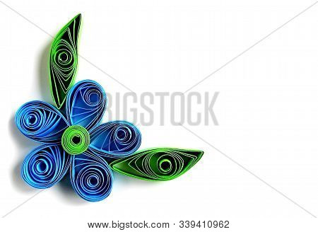 Origami Blue Flower & Paper Green Leaves Frame In Quilling Technique. Beautiful Origami Paper Flower